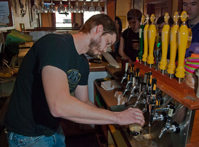 Rick Logan of Lompoc Brewery's Hedge House tries to keep pace with walkers' thirst. Photo by Nolan Hester.